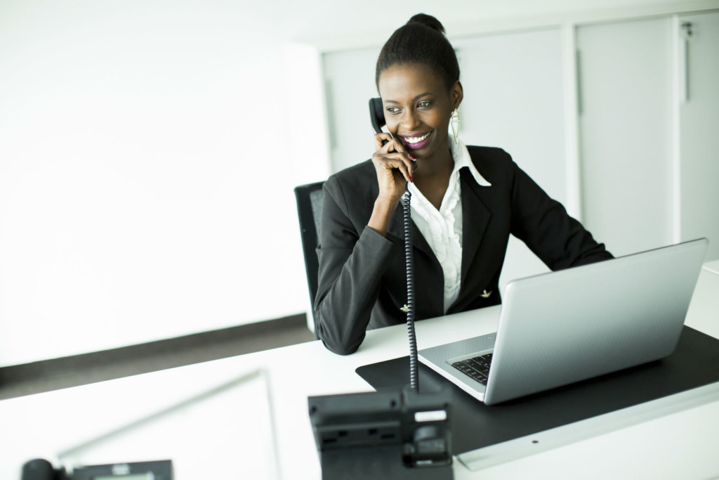 businesswoman listening to the perfect on hold message